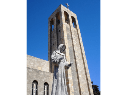 The statue of St. Francis, Cruise shore excursions in Rhodes Greece